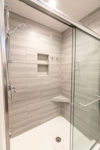 walk in shower with shelving