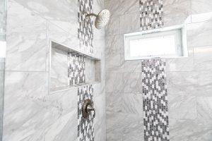 grey shower with black horizontal patterned tile